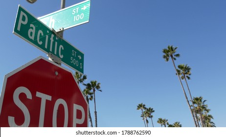Pacific street road sign on crossroad, route 101 tourist destination, California, USA. Lettering on intersection signpost, symbol of summertime travel and vacations.Signboard in city near Los Angeles.