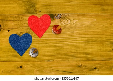 Pacifier for baby boy and girl with heart shape on wooden table.Baby announcement concept.Toned photo.