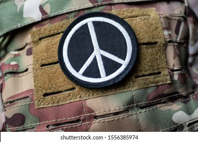 Pacifism: Velcro Peace Sign on camouflage backpack. This sign: Although specifically designed for the anti-nuclear movement, it was deliberately not copyrighted and has become known worldwide for peace
