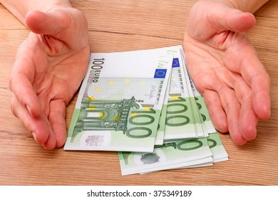 Pack of bank notes hundred euros and hands