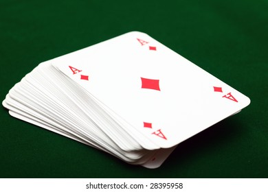 Pack of cards with ace of diamond on the green background