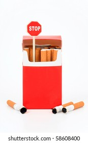 "Pack of cigarets and sign ""Stop"" on a white background"