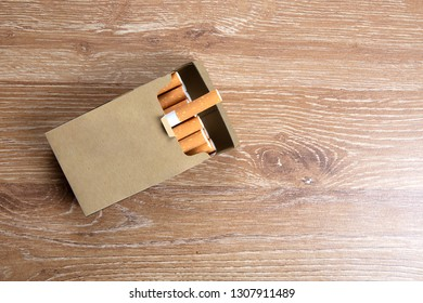 Pack of cigarettes on a wooden background