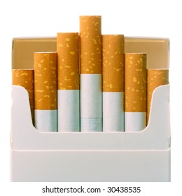 Pack of cigarettes with cigarettes sticking out isolated on white.