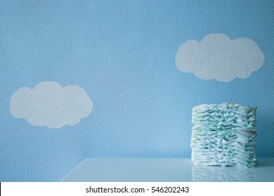 A pack of diapers on a background of clouds and sky