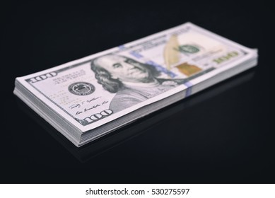 pack dollars on a black background