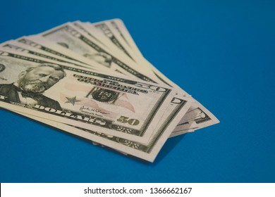 Pack of fifty dollars banknotes isolated on blue background