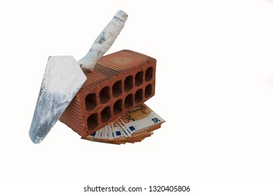 a pack of fifty-Euro notes lie under the brick, and old construction tools