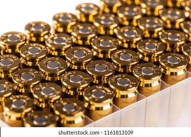 a pack full of unused 9mm bullets isolated on white