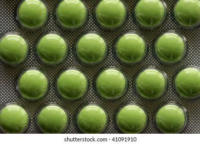 Pack of Green Pills Closeup