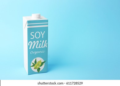 Pack of soy milk on blue background