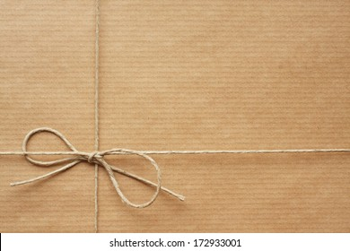 Pack wrapped in wrapping paper, tied with string. Empty space for Your text