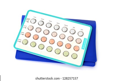 package of birth control pills white background