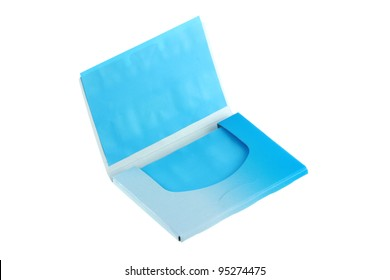 A package of Blue Oil absorbing (blotting) sheets to remove excess oil on oily face, isolated on white background