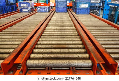 package boxes on industrial conveyor line.