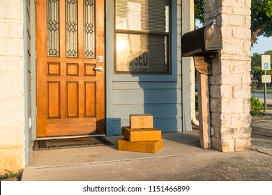 Package Delivery left on Doorstep of Local Small Business Closed at Sunset with sunshine on building front porch