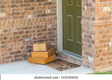 Package delivery on doorstep. Boxes and postal delivery on modern brick home doorstep on front