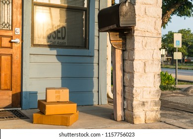 Package delivery , small boxes left on doorstep oh small home business with mailbox and closed sign in window