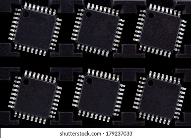 package of six microcontrollers as a background