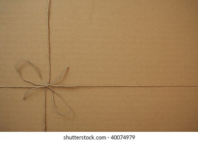 package tied up with string