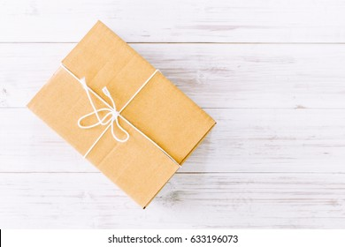 Packaged boxes delivery on wooden background