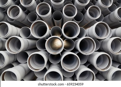 Packaged plastic water pipes at warehouse.