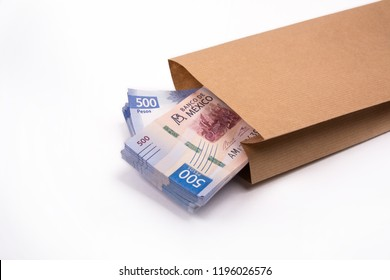 packages of 500 Mexican pesos bills inside a paper bag