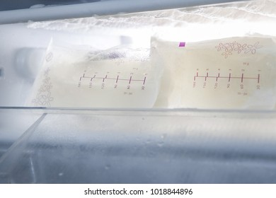 packages with breast milk in freezer.