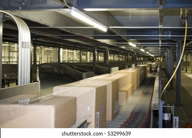 Packages distributed on conveyor belt on automated system