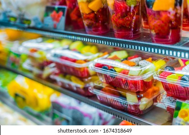 Packages with fresh fruits displayed in a commercial refrigerator