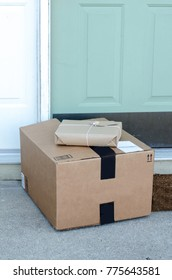 packages wrapped in brown paper and generic markings are left on the door step of a home