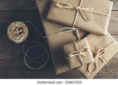 Packages wrapped in kraft paper tied with jute