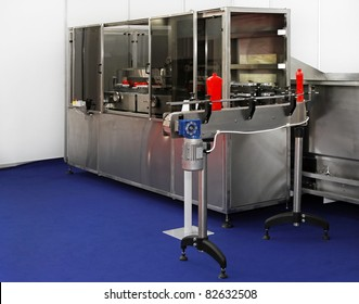 Packaging machine for packing ketchup in plastic bottles