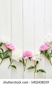 packaging template, layout of peonies on wooden white background
