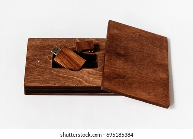 Packaging for USB drive. Dark Wooden box with USB-storage for a photographer, on a white isolated background. Copy space