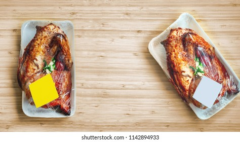 Packed chickens grill on table