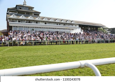 A packed crowd in the Grandstand watching horse racing at Thirsk Races : Thirsk Racecourse, Thirsk, North Yorkshire, UK : 19 May 2018 : Pic Mick Atkins