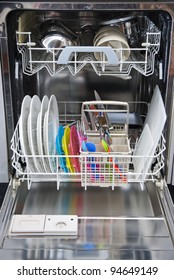 Packed dishwasher of clean dishes for a family