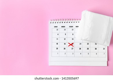 Packed menstrual pads and calendar on color background, flat lay with space for text. Gynecological care