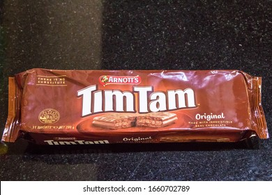 Packet of Arnotts Tim Tam chocolate biscuits.