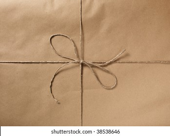 A packet closed with a string and bow.