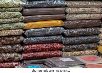 Packets of various spices piled high on a market stall in Zanzibar Stone town.