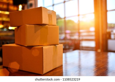 packing accessories at workplace of startup small business owner, cardboard parcel box for online selling. entrepreneur, SME seller's desk. e-commerce, shipping concept