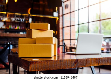 Packing accessories at workplace of startup small business owner, cardboard parcel box for online selling. entrepreneur,cardboard parcel box for online selling.shipping concept.
