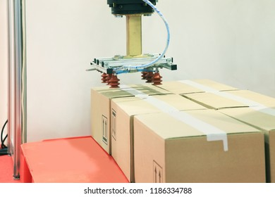Packing of boxes by industrial robot with vacuum mechanism in the warehouse