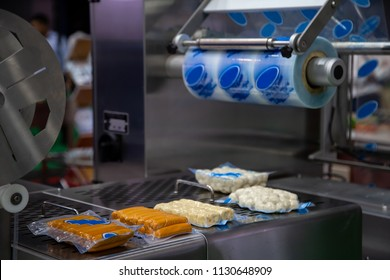 Packing food sausage and meat ball in production line