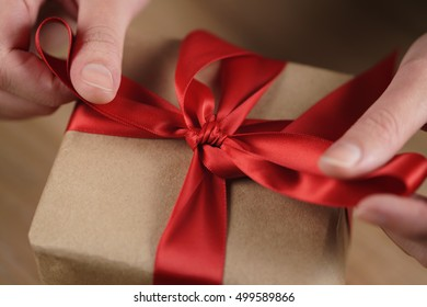 packing gift box with red ribbon, craft paper box