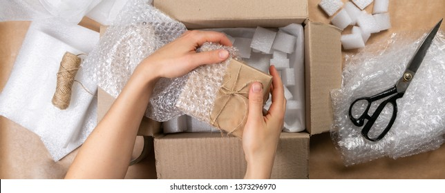 Packing products for delivery, shipping service. Delivery concept for private companies delivery with care , Craft present box