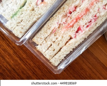 Packing sandwiches food on wood backgrounds