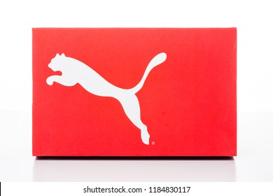 Packing for sport shoes, sneakers. New modern colorful blank cardboard paper box branding with logo Nike, Puma, Adidas isolated on abstract blurred white background.